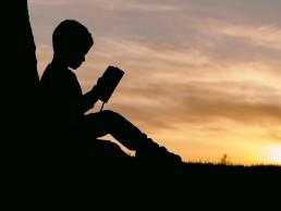 Reluctant Readers - Image Credit: Aaron Burden, Unsplash